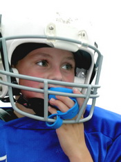 Child in Football Helmet With Mouthguard at Pediatric Dentist Office in Clarks Summit