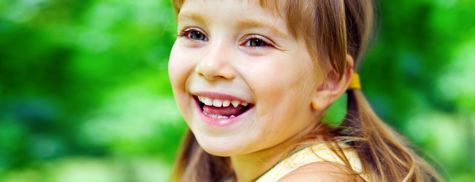 Little Girl in the Grass - Pediatric Dentists in Clarks Summit, PA